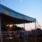The moon rises over the Black Hawk tent