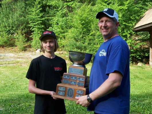 Joe Graf, RI Outdoor Metric 3P State Champion (right) and Alex Muzzioli, Junior State Champion, holding the Jules Epstein Trophy