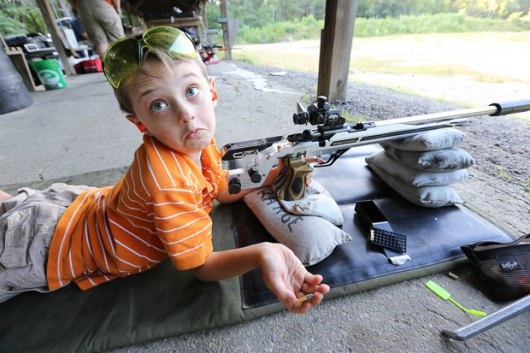 (7/12/12, HOPKINTON, MA) Ethan Holmes, 6, settles in to shoot the Hopkinton Prone matches. Photo/Dan Holmes
