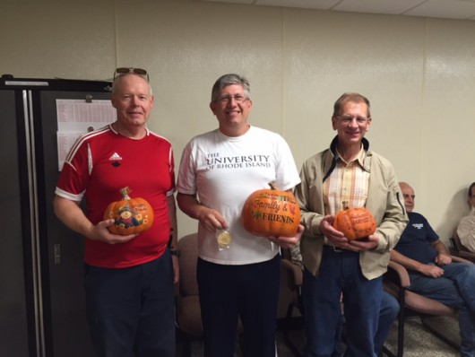 Great Pumpkin winners display trophies Gale Stewart, Joe Graf, and Jeff Doerschler. Expert class winner Garbouchian winner relaxes and watches the proceedings over Doerschler's shoulder