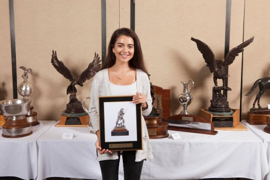 University of Kentucky bound Ruby Gomes displays the Charlie Rogers Trophy plaque, emblematic of the national  Expert class prone champion which she won at 2017 at the National Smallbore Rifle Prone Championships. Photo credit NRA